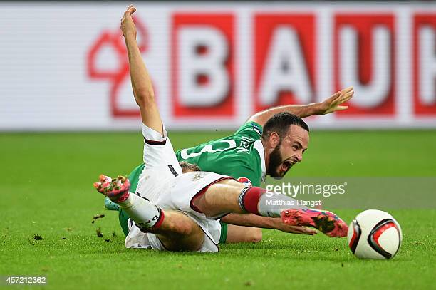 Marc Wilson of the Republic of Ireland clashes with Thomas Mueller of Germany during the EURO 2016 Qualifier between Germany and Republic of Ireland...