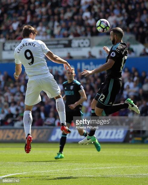 Marc Wilson of West Bromwich Albion heads the ball away from Fernando Llorente of Swansea City during the Premier League match between Swansea City...