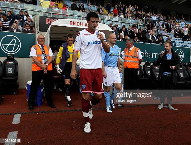 Marc Wilson the Portsmouth captain leads his team out during the npower Championship match between Coventry City and Portsmouth at the Ricoh Arena on...