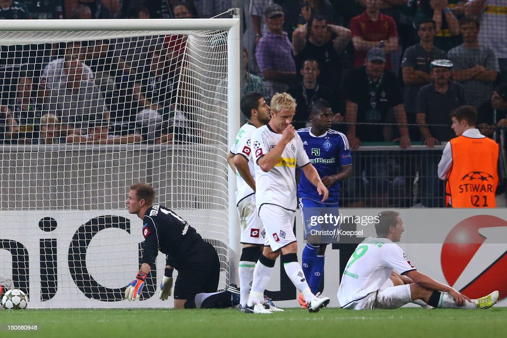 Marc-André ter Stegen, Tolga Cigerci, <a gi-track='captionPersonalityLinkClicked' href=/galleries/search?phrase=Mike+Hanke&family=editorial&specificpeople=206515 ng-click='$event.stopPropagation()'>Mike Hanke</a> and Luuk de Jong of Moenchengladbach look dejected after the third goal of Kiew during the UEFA Champions League play-off first leg match between Borussia Moenchengladbach and Dynamo Kiew at Borussia Park Stadium on August 21, 2012 in Moenchengladbach, Germany.