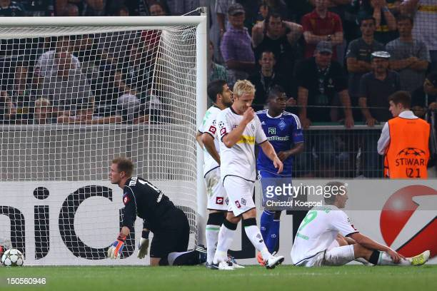 MarcAndré ter Stegen Tolga Cigerci Mike Hanke and Luuk de Jong of Moenchengladbach look dejected after the third goal of Kiew during the UEFA...