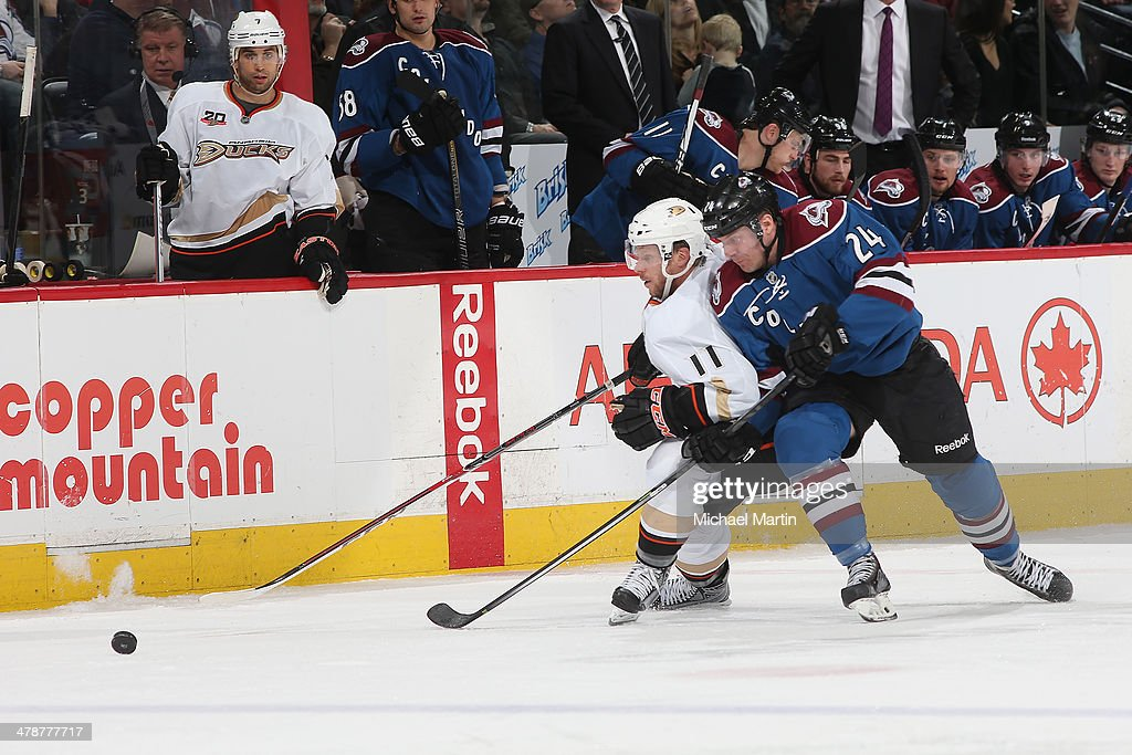Marc-Andre Cliche #24 of the Colorado Avalanche fights for position against <a gi-track='captionPersonalityLinkClicked' href=/galleries/search?phrase=Saku+Koivu&family=editorial&specificpeople=202253 ng-click='$event.stopPropagation()'>Saku Koivu</a> #11 of the Anaheim Ducks at the Pepsi Center on March 14, 2014 in Denver, Colorado. The Ducks defeated the Avalanche 6-4.