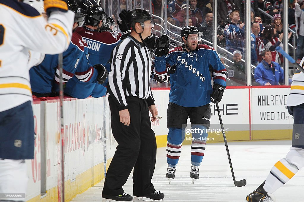 Marc-Andre Cliche #24 of the Colorado Avalanche is sprayed with water by teammates after scoring his first goal in the NHL against the Buffalo Sabres at the Pepsi Center on February 1, 2014 in Denver, Colorado.