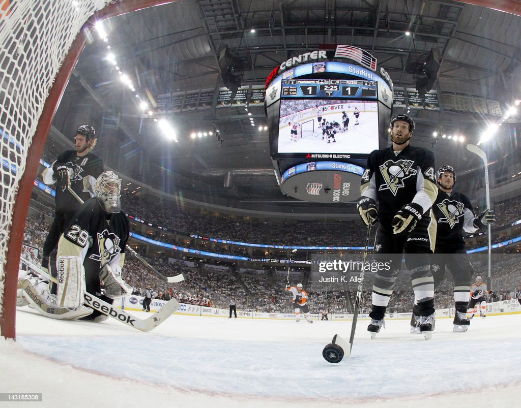 <a gi-track='captionPersonalityLinkClicked' href=/galleries/search?phrase=Marc-Andre+Fleury&family=editorial&specificpeople=233779 ng-click='$event.stopPropagation()'>Marc-Andre Fleury</a> #29 and <a gi-track='captionPersonalityLinkClicked' href=/galleries/search?phrase=Brooks+Orpik&family=editorial&specificpeople=213074 ng-click='$event.stopPropagation()'>Brooks Orpik</a> #44 of the Pittsburgh Penguins react after giving up a goal to Scott Hartnell #19 of the Philadelphia Flyers (not pictured) in Game Five of the Eastern Conference Quarterfinals during the 2012 NHL Stanley Cup Playoffs at Consol Energy Center on April 20, 2012 in Pittsburgh, Pennsylvania.