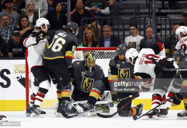 MarcAndre Fleury and Deryk Engelland of the Vegas Golden Knights defend against the Arizona Coyotes during the Golden Knights' inaugural...