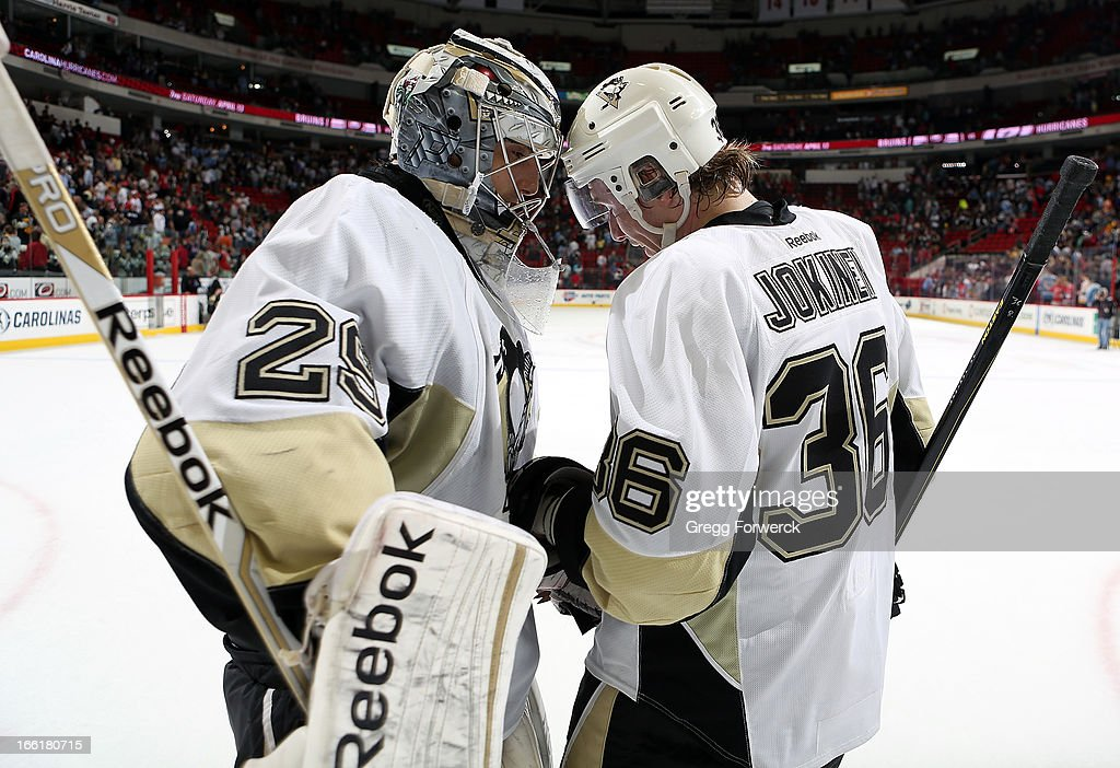 <a gi-track='captionPersonalityLinkClicked' href=/galleries/search?phrase=Marc-Andre+Fleury&family=editorial&specificpeople=233779 ng-click='$event.stopPropagation()'>Marc-Andre Fleury</a> #35 and <a gi-track='captionPersonalityLinkClicked' href=/galleries/search?phrase=Jussi+Jokinen&family=editorial&specificpeople=570599 ng-click='$event.stopPropagation()'>Jussi Jokinen</a> #36 of the Pittsburgh Penguins celebrate the team's 5-3 victory over the Carolina Hurricanes following an NHL game at PNC Arena on April 9, 2013 in Raleigh, North Carolina. Tonight marks the first time Jokinen has played against his former teammates after he was dealt to the Penguins for a conditional 2013 sixth or seventh round draft pick.