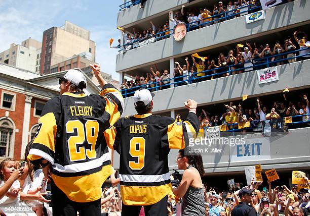 MarcAndre Fleury and Pascal Dupuis of the Pittsburgh Penguins celebrate during the Victory Parade and Rally on June 15 2016 in Pittsburgh...