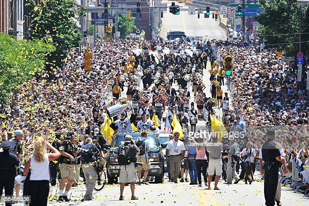 MarcAndre Fleury and Sidney Crosby of the Pittsburgh Penguins proceed down the Blvd of the Allies with the Stanley Cup during Stanley Cup Champion...