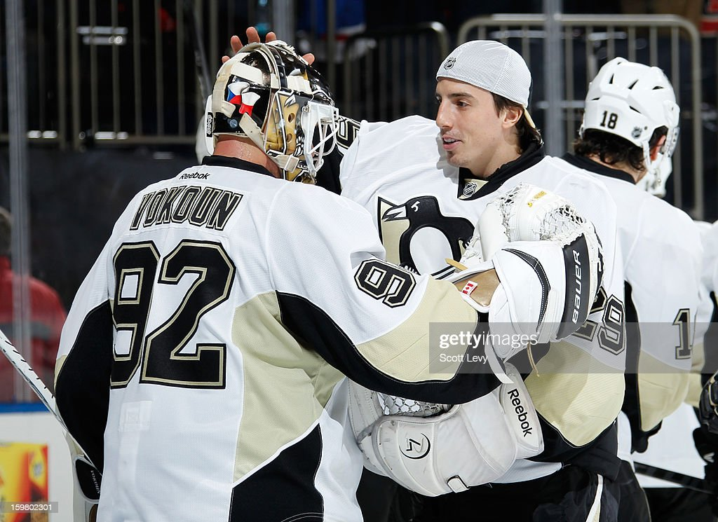 <a gi-track='captionPersonalityLinkClicked' href=/galleries/search?phrase=Marc-Andre+Fleury&family=editorial&specificpeople=233779 ng-click='$event.stopPropagation()'>Marc-Andre Fleury</a> #29 congratulates <a gi-track='captionPersonalityLinkClicked' href=/galleries/search?phrase=Tomas+Vokoun&family=editorial&specificpeople=202179 ng-click='$event.stopPropagation()'>Tomas Vokoun</a> #92 of the New York Rangers on his win against the Pittsburgh Penguins at Madison Square Garden on January 20, 2013 in New York City. The Penguins defeat the Rangers 6-3.