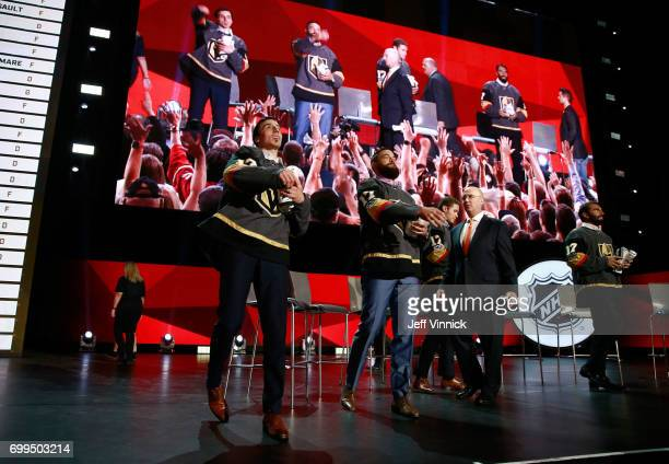 MarcAndre Fleury Deryk Engelland and Jason Garrison throw gifts to the fans from the stage during the Vegas Golden Knights Round Table Rally after...