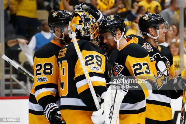 MarcAndre Fleury of the Pittsburgh Penguins celebrates a 41 win over the Columbus Blue Jackets with Scott Wilson in Game Two of the Eastern...