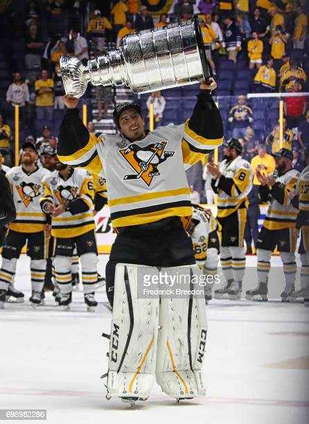 MarcAndre Fleury of the Pittsburgh Penguins celebrates with the Stanley Cup trophy after defeating the Nashville Predators 20 in Game Six of the 2017...