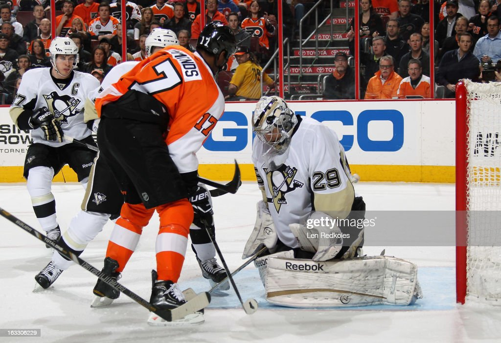 Marc-Andre Fleury #29 of the Pittsburgh Penguins collapses on the puck as Wayne Simmonds #17 of the Philadelphia Flyers looks for a rebound chance on March 7, 2013 at the Wells Fargo Center in Philadelphia, Pennsylvania.