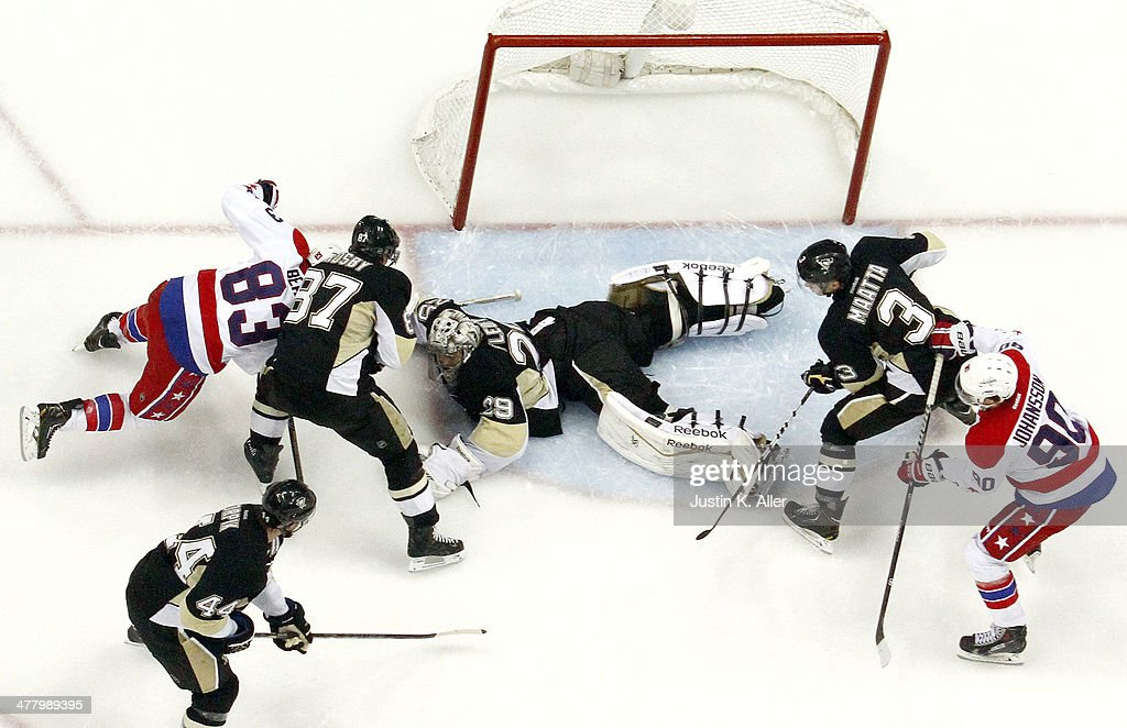 <a gi-track='captionPersonalityLinkClicked' href=/galleries/search?phrase=Marc-Andre+Fleury&family=editorial&specificpeople=233779 ng-click='$event.stopPropagation()'>Marc-Andre Fleury</a> #29 of the Pittsburgh Penguins covers a rebound against <a gi-track='captionPersonalityLinkClicked' href=/galleries/search?phrase=Jay+Beagle&family=editorial&specificpeople=4671535 ng-click='$event.stopPropagation()'>Jay Beagle</a> #83 of the Washington Capitals during the game at Consol Energy Center on March 11, 2014 in Pittsburgh, Pennsylvania.