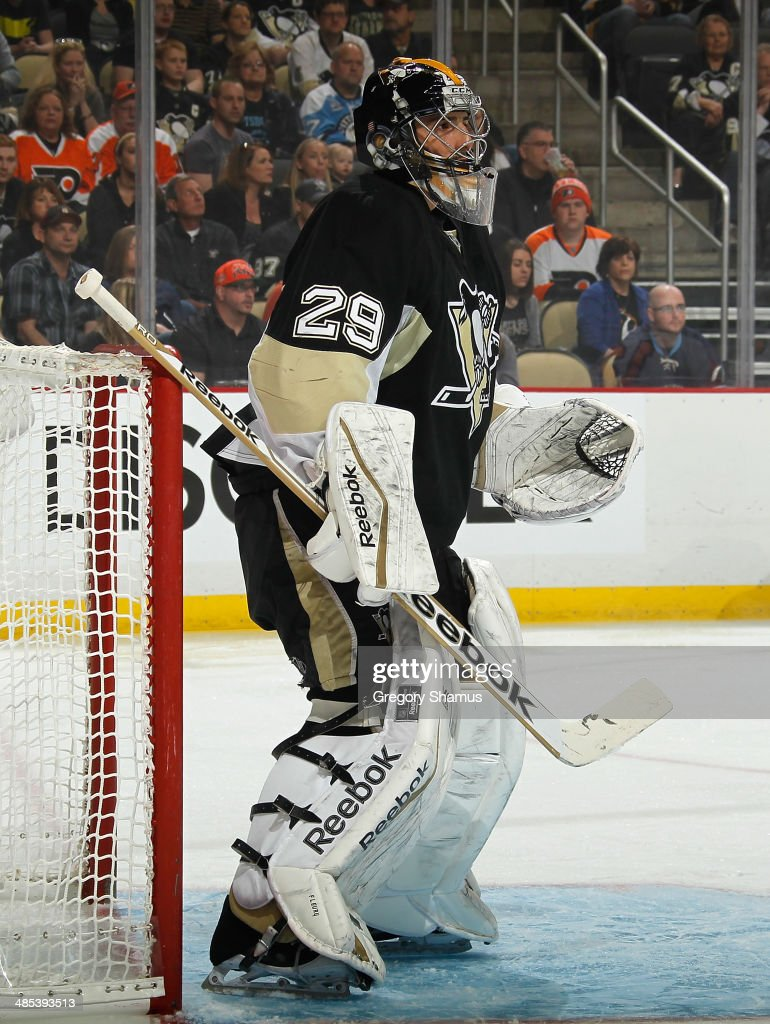 Marc-Andre Fleury #29 of the Pittsburgh Penguins defends the net against the Philadelphia Flyers on April 12, 2014 at Consol Energy Center in Pittsburgh, Pennsylvania.