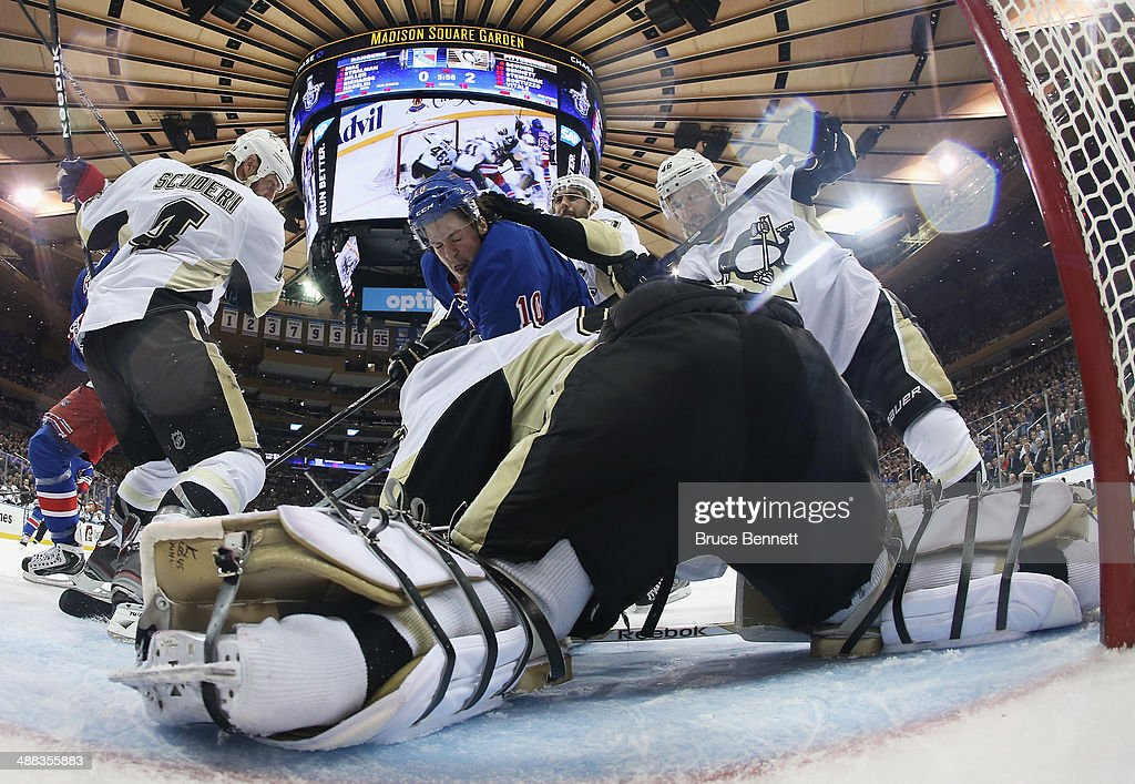<a gi-track='captionPersonalityLinkClicked' href=/galleries/search?phrase=Marc-Andre+Fleury&family=editorial&specificpeople=233779 ng-click='$event.stopPropagation()'>Marc-Andre Fleury</a> #29 of the Pittsburgh Penguins defends the net against <a gi-track='captionPersonalityLinkClicked' href=/galleries/search?phrase=J.T.+Miller&family=editorial&specificpeople=4663469 ng-click='$event.stopPropagation()'>J.T. Miller</a> #10 of the New York Rangers in Game Three of the Second Round of the 2014 NHL Stanley Cup Playoffs at Madison Square Garden on May 5, 2014 in New York City. Penguins defeated the Rangers 2-0.