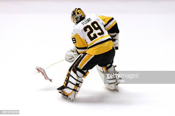 MarcAndre Fleury of the Pittsburgh Penguins hits a catfish with his stick prior to Game Three of the 2017 NHL Stanley Cup Final against the Nashville...