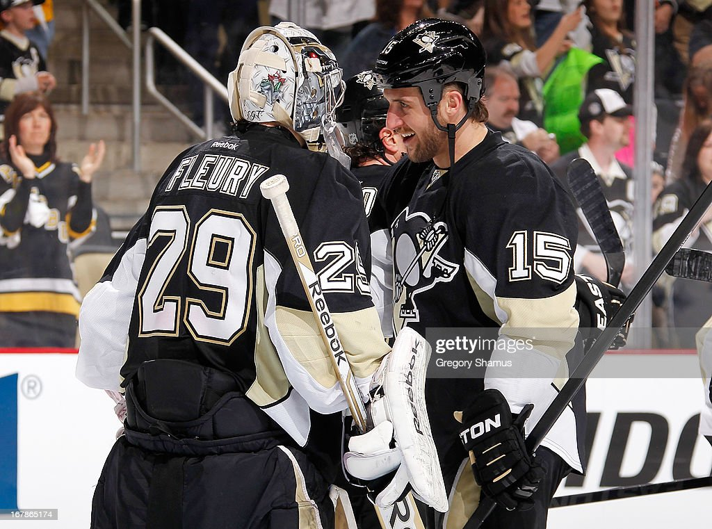<a gi-track='captionPersonalityLinkClicked' href=/galleries/search?phrase=Marc-Andre+Fleury&family=editorial&specificpeople=233779 ng-click='$event.stopPropagation()'>Marc-Andre Fleury</a> #29 of the Pittsburgh Penguins is congratulated by <a gi-track='captionPersonalityLinkClicked' href=/galleries/search?phrase=Tanner+Glass&family=editorial&specificpeople=4596666 ng-click='$event.stopPropagation()'>Tanner Glass</a> #15 after a 5-0 win over the New York Islanders in Game One of the Eastern Conference Quarterfinals during the 2013 NHL Stanley Cup Playoffs at Consol Energy Center on May 1, 2013 in Pittsburgh, Pennsylvania.