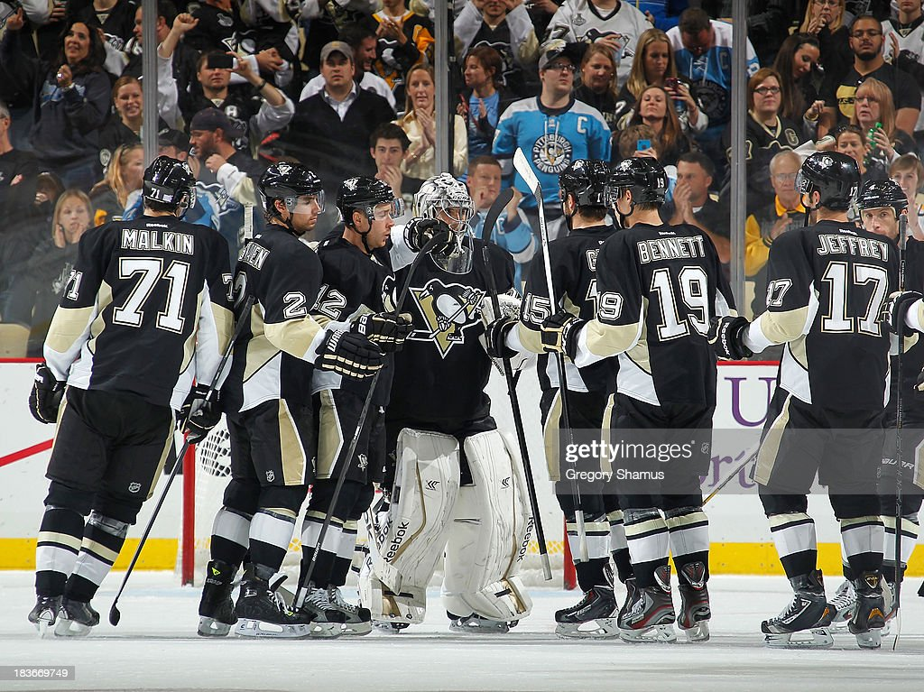 <a gi-track='captionPersonalityLinkClicked' href=/galleries/search?phrase=Marc-Andre+Fleury&family=editorial&specificpeople=233779 ng-click='$event.stopPropagation()'>Marc-Andre Fleury</a> #29 of the Pittsburgh Penguins is congratulated by teammates after a 5-2 win over the Carolina Hurricanes on October 8, 2013 at Consol Energy Center in Pittsburgh, Pennsylvania.