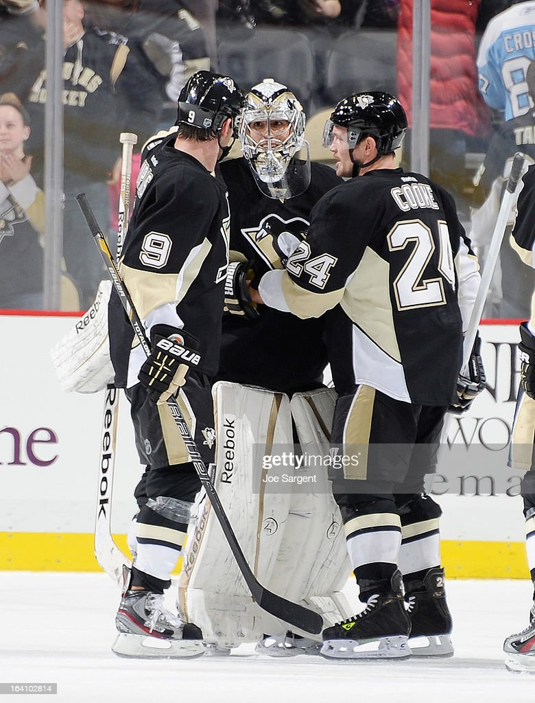 Marc-Andre Fleury #29 of the Pittsburgh Penguins is congratulated by Pascal Dupuis #9 and Matt Cooke #24 after a 2-1 win over the Washington Capitals on March 19, 2013 at Consol Energy Center in Pittsburgh, Pennsylvania.