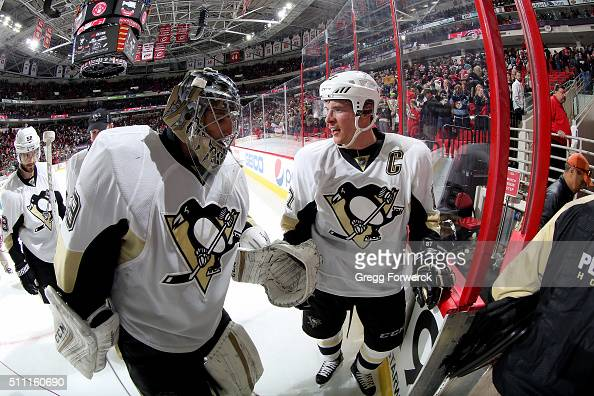 MarcAndre Fleury of the Pittsburgh Penguins is congratulated by teammate Sidney Crosby after defeating the Carolina Hurricanes during an NHL game at...