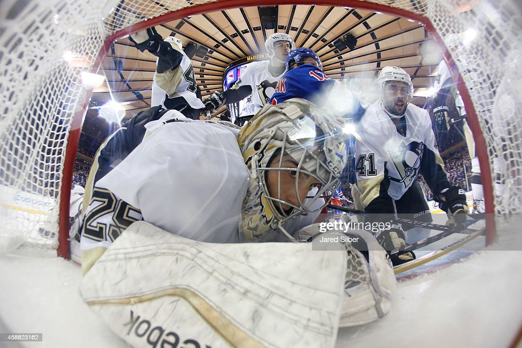 <a gi-track='captionPersonalityLinkClicked' href=/galleries/search?phrase=Marc-Andre+Fleury&family=editorial&specificpeople=233779 ng-click='$event.stopPropagation()'>Marc-Andre Fleury</a> #29 of the Pittsburgh Penguins is knocked into the net during a pile up in the crease against the New York Rangers at Madison Square Garden on November 11, 2014 in New York City.