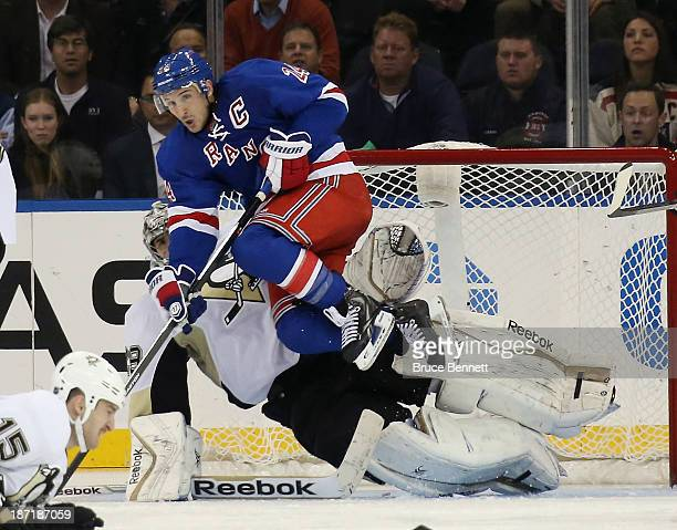 MarcAndre Fleury of the Pittsburgh Penguins is screened by Ryan Callahan of the New York Rangers during the third period at Madison Square Garden on...