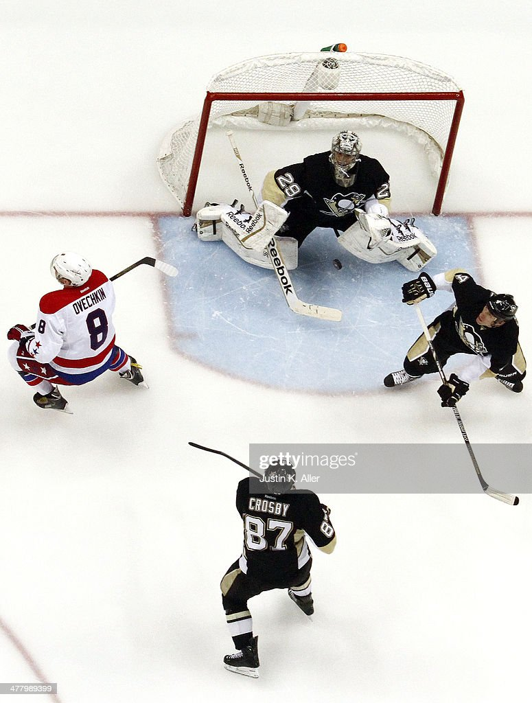 <a gi-track='captionPersonalityLinkClicked' href=/galleries/search?phrase=Marc-Andre+Fleury&family=editorial&specificpeople=233779 ng-click='$event.stopPropagation()'>Marc-Andre Fleury</a> #29 of the Pittsburgh Penguins keeps an eye on a airborne puck against Alex Ovechkin #8 of the Washington Capitals during the game at Consol Energy Center on March 11, 2014 in Pittsburgh, Pennsylvania.