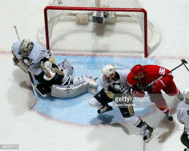 MarcAndre Fleury of the Pittsburgh Penguins makes a diving save in the final seconds of the third period as teammate Rob Scuderi ties up Tomas...