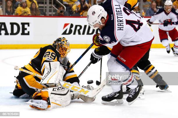 MarcAndre Fleury of the Pittsburgh Penguins makes a first period save on Scott Hartnell of the Columbus Blue Jackets in Game One of the Eastern...