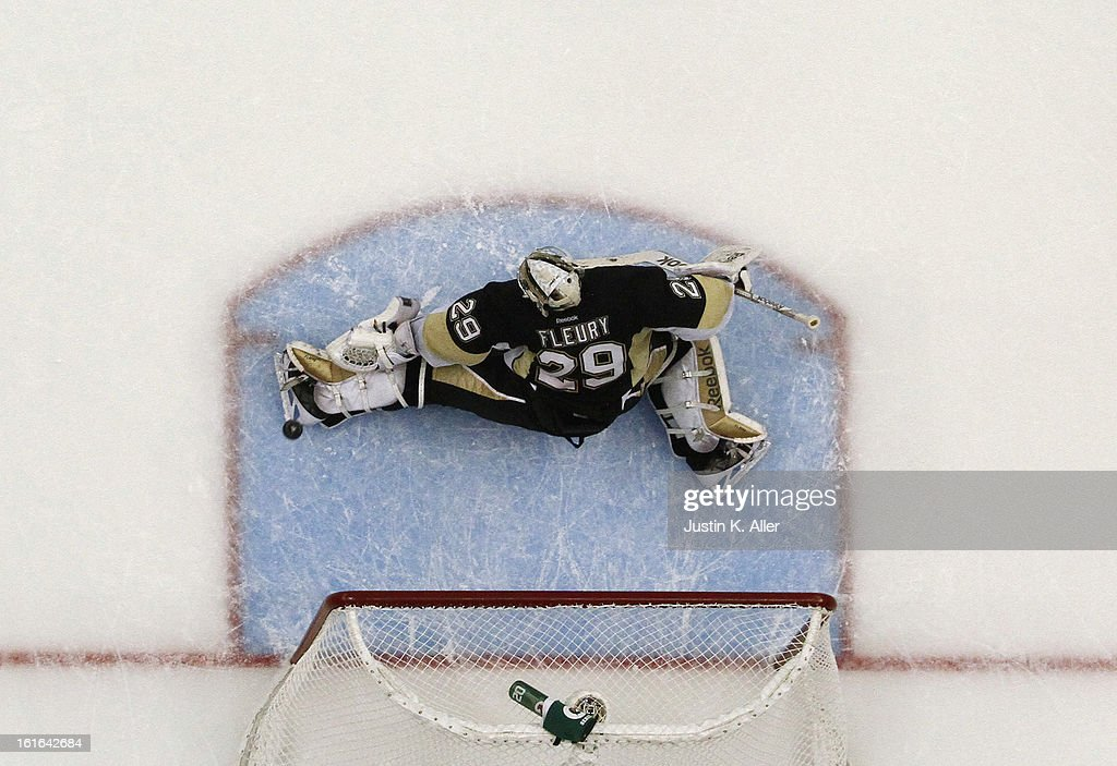 <a gi-track='captionPersonalityLinkClicked' href=/galleries/search?phrase=Marc-Andre+Fleury&family=editorial&specificpeople=233779 ng-click='$event.stopPropagation()'>Marc-Andre Fleury</a> #29 of the Pittsburgh Penguins makes a kick save against the Ottawa Senators during the game at Consol Energy Center on February 13, 2013 in Pittsburgh, Pennsylvania. The Penguins won 4-2.