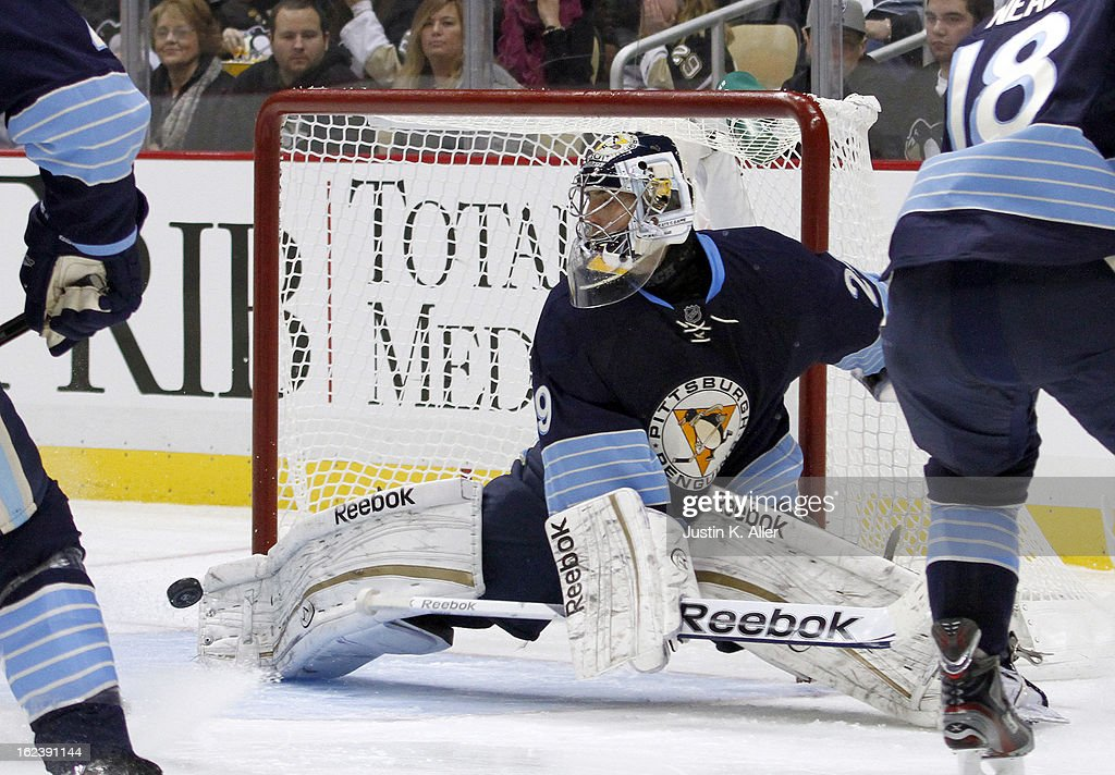 Marc-Andre Fleury #29 of the Pittsburgh Penguins makes a kick save against the Florida Panthers during the game at Consol Energy Center on February 22, 2013 in Pittsburgh, Pennsylvania.
