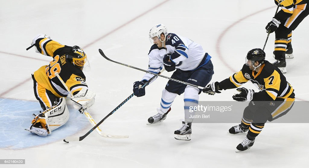 Marc-Andre Fleury #29 of the Pittsburgh Penguins makes a save against Joel Armia #40 of the Winnipeg Jets in the third period during the game at PPG PAINTS Arena on February 16, 2017 in Pittsburgh, Pennsylvania.