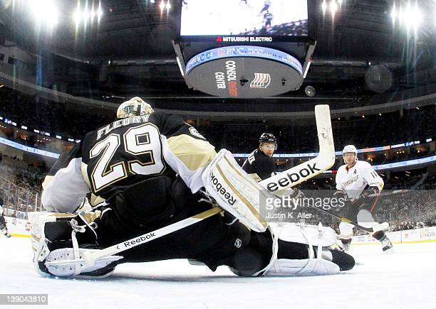 MarcAndre Fleury of the Pittsburgh Penguins makes a save against the Anaheim Ducks during the game at Consol Energy Center on February 15 2012 in...