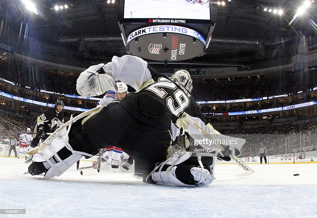 <a gi-track='captionPersonalityLinkClicked' href=/galleries/search?phrase=Marc-Andre+Fleury&family=editorial&specificpeople=233779 ng-click='$event.stopPropagation()'>Marc-Andre Fleury</a> #29 of the Pittsburgh Penguins makes a save against the New York Rangers while recording his 23rd franchise leading shut out during the game at Consol Energy Center on March 16, 2013 in Pittsburgh, Pennsylvania. The Penguins defeated the Rangers 3-0.