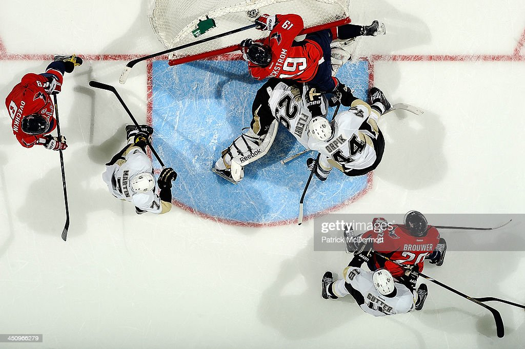 <a gi-track='captionPersonalityLinkClicked' href=/galleries/search?phrase=Marc-Andre+Fleury&family=editorial&specificpeople=233779 ng-click='$event.stopPropagation()'>Marc-Andre Fleury</a> #29 of the Pittsburgh Penguins makes a save against the Washington Capitals in the first period during an NHL game at Verizon Center on November 20, 2013 in Washington, DC.