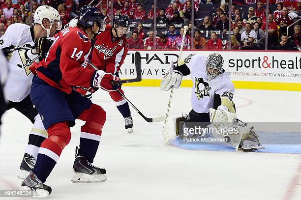 MarcAndre Fleury of the Pittsburgh Penguins makes a save against the Washington Capitals in the third period of an NHL game during Hockey Fights...