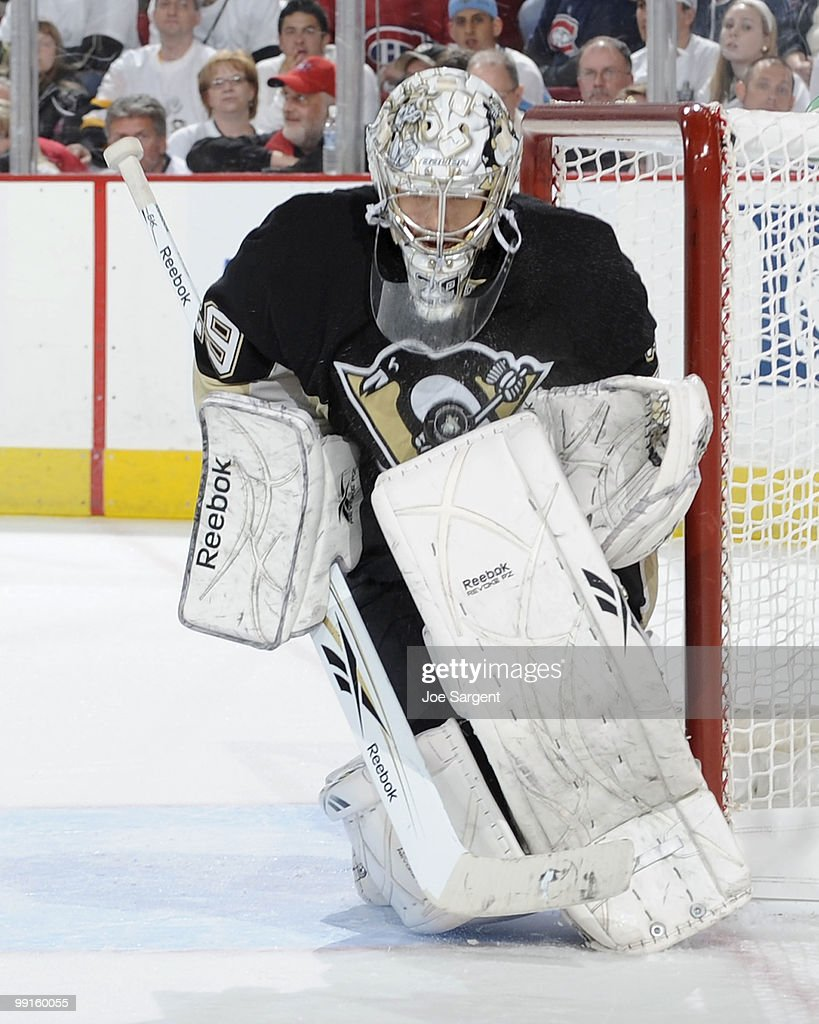 MarcAndre Fleury of the Pittsburgh Penguins makes a save against the Montreal Canadiens in Game Seven of the Eastern Conference Semifinals during the...