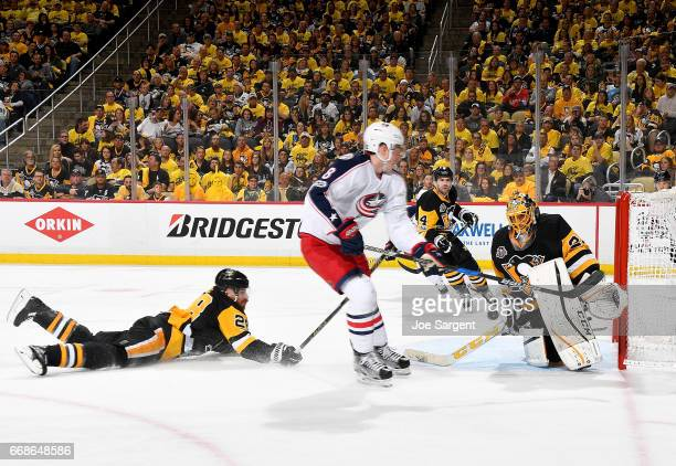 MarcAndre Fleury of the Pittsburgh Penguins makes a save against Zach Werenski of the Columbus Blue Jackets in Game Two of the Eastern Conference...