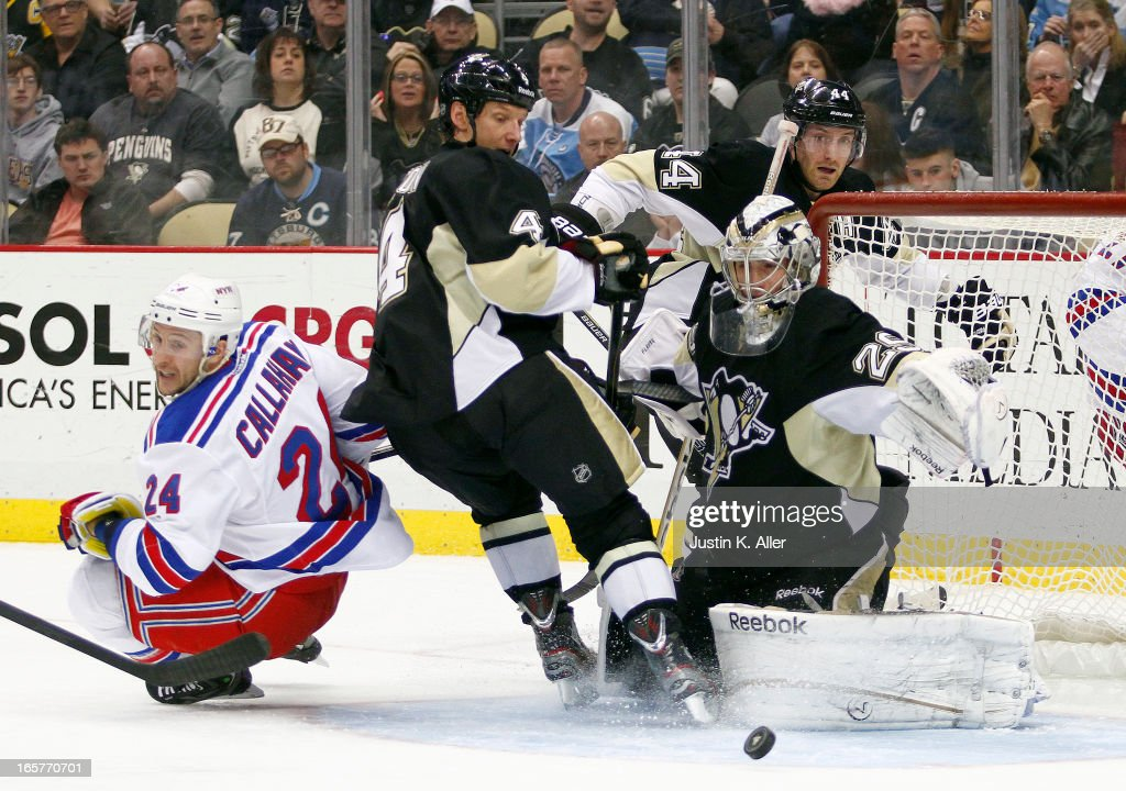 Marc-Andre Fleury #29 of the Pittsburgh Penguins makes a save behind teammate Mark Eaton #4 and Ryan Callahan #24 of the New York Rangers during the game at Consol Energy Center on April 5, 2013 in Pittsburgh, Pennsylvania.