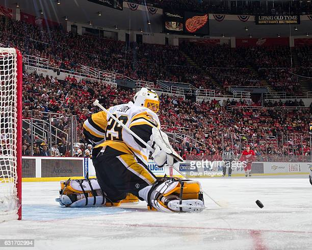 MarcAndre Fleury of the Pittsburgh Penguins makes a save during an NHL game against the Detroit Red Wings at Joe Louis Arena on January 14 2017 in...