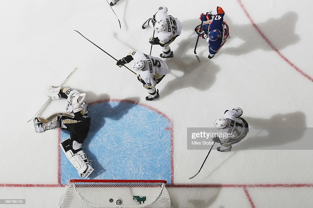 Marc-Andre Fleury #29 of the Pittsburgh Penguins makes a save during the game against the New York Islanders at Nassau Veterans Memorial Coliseum on Febuary 5, 2013 in Uniondale, New York. The Penguins defeated the Islanders 4-2. (Photo by Mike Stobe/NHLI via Getty Images) save