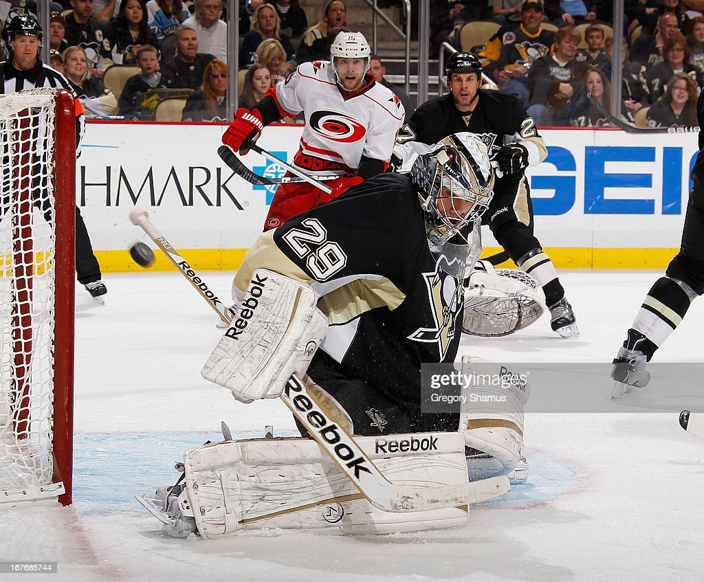 <a gi-track='captionPersonalityLinkClicked' href=/galleries/search?phrase=Marc-Andre+Fleury&family=editorial&specificpeople=233779 ng-click='$event.stopPropagation()'>Marc-Andre Fleury</a> #29 of the Pittsburgh Penguins makes a save during the third period against the Carolina Hurricanes on April 27, 2013 at Consol Energy Center in Pittsburgh, Pennsylvania. Pittsburgh won the game 8-3.