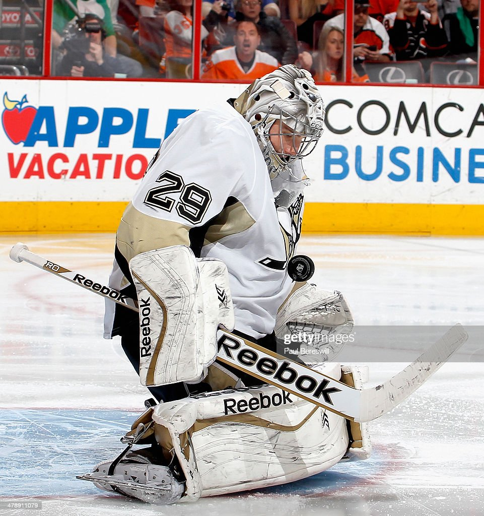 Marc-Andre Fleury #29 of the Pittsburgh Penguins makes a save in the second period of an NHL hockey game against the Philadelphia Flyers at Wells Fargo Center on March 15, 2014 in Philadelphia, Pennsylvania.