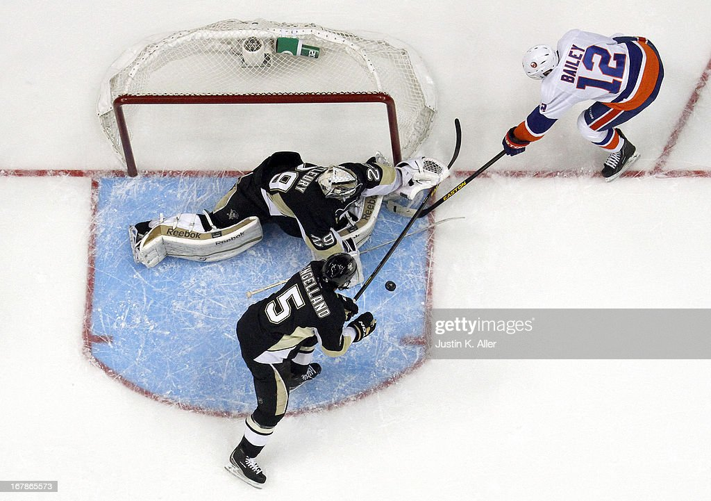 <a gi-track='captionPersonalityLinkClicked' href=/galleries/search?phrase=Marc-Andre+Fleury&family=editorial&specificpeople=233779 ng-click='$event.stopPropagation()'>Marc-Andre Fleury</a> #29 of the Pittsburgh Penguins makes a save on <a gi-track='captionPersonalityLinkClicked' href=/galleries/search?phrase=Josh+Bailey+-+Ice+Hockey+Player&family=editorial&specificpeople=3321456 ng-click='$event.stopPropagation()'>Josh Bailey</a> #12 of the New York Islanders in Game One of the Eastern Conference Quarterfinals during the 2013 NHL Stanley Cup Playoffs at Consol Energy Center on May 1, 2013 in Pittsburgh, Pennsylvania. The Penguins won 5-0.