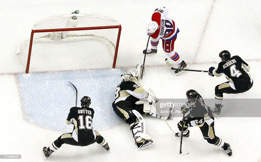 Marc-Andre Fleury #29 of the Pittsburgh Penguins makes a save on Marcus Johansson #90 of the Washington Capitals in the third period during the game at Consol Energy Center on March 11, 2014 in Pittsburgh, Pennsylvania.