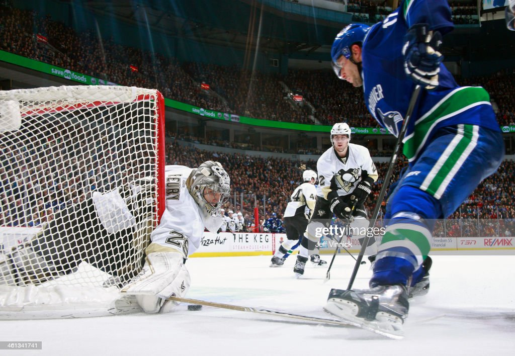<a gi-track='captionPersonalityLinkClicked' href=/galleries/search?phrase=Marc-Andre+Fleury&family=editorial&specificpeople=233779 ng-click='$event.stopPropagation()'>Marc-Andre Fleury</a> #29 of the Pittsburgh Penguins makes a save on <a gi-track='captionPersonalityLinkClicked' href=/galleries/search?phrase=Ryan+Kesler&family=editorial&specificpeople=206915 ng-click='$event.stopPropagation()'>Ryan Kesler</a> #17 of the Vancouver Canucks during their NHL game at Rogers Arena January 7, 2014 in Vancouver, British Columbia, Canada. Pittsburgh won 5-4.