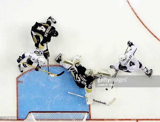 MarcAndre Fleury of the Pittsburgh Penguins makes a save on Vincent Lecavalier of the Tampa Bay Lightning in Game One of the Eastern Conference...