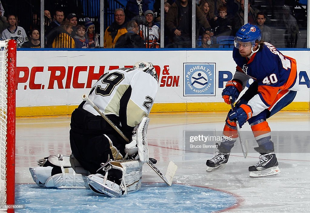 Marc-Andre Fleury #29 of the Pittsburgh Penguins makes a second period save against Michael Grabner #40 of the New York Islanders at the Nassau Veterans Memorial Coliseum on February 5, 2013 in Uniondale, New York.