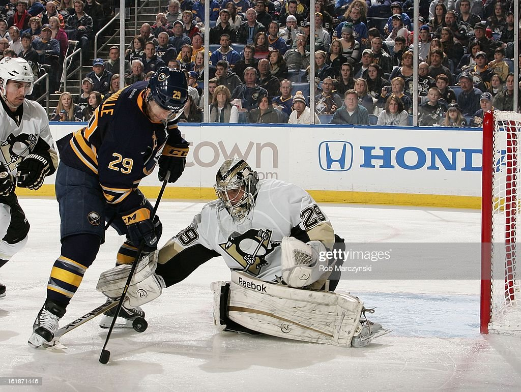 Marc-Andre Fleury #29 of the Pittsburgh Penguins makes a third period save on <a gi-track='captionPersonalityLinkClicked' href=/galleries/search?phrase=Jason+Pominville&family=editorial&specificpeople=570525 ng-click='$event.stopPropagation()'>Jason Pominville</a> #29 of the Buffalo Sabres on February 17, 2013 at the First Niagara Center in Buffalo, New York. Pittsburgh defeated Buffalo, 4-3.